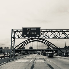Let's go... (noitalsnarT_nI_tsoL) Tags: road blackandwhite bw chicago blancoynegro highway scaffolding trafficsign bridge turn left west east 94 exit