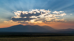 Smoky Rays (Kurt Lawson) Tags: backlight blue clouds crepuscular idaho mountains orange rays roadside shadow shaodws sky smoke sunset wilderness
