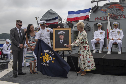Cindy McCain is presented with a painting of her husband during the 25th anniversary of the ship's commissioning.