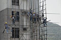 "retrospective: ""stay safe"" (Oct 2006) (hugo poon - one day in my life) Tags: nikond80 retrospective 2006 hongkong midlevels babingtonroad scaffolding safe stunt"