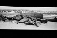 (Delay Tactics) Tags: borth wales beach sand shore sea seaside side concrete pipe rocks boulders houses front hills film wide black white blackandwhite monochrome bw pano panorama