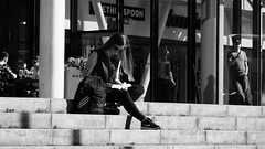 Reading in the Sun (byronv2) Tags: edinburgh edimbourg scotland peoplewatching street candid reading book woman sitting seated steps stairs sunny sunshine sunglasses omnicentre greenside blackandwhite blackwhite bw monochrome people sit