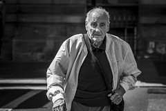 A Pedestrian, Crossing (Leanne Boulton) Tags: urban street candid portrait portraiture streetphotography candidstreetphotography candidportrait streetportrait eyecontact candideyecontact streetlife old man male face eyes expression emotion mood feeling walking crossing pedestrian tone texture detail depthoffield bokeh naturallight outdoor summer sunlight light shade shadow city scene human life living humanity society culture lifestyle people canon canon5dmkiii 70mm ef2470mmf28liiusm black white blackwhite bw mono blackandwhite monochrome glasgow scotland uk