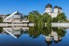 Reflections at the lake (Daniel Boca) Tags: water lake reflection reflections arad romania outdoor outside blue bluesky clearwater clearsky trees green city cityscape waterscape landscape canon canoneos750d canoneurope canonromania cathedral building architecture architectural windows