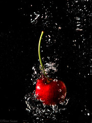 Cherry bomb (Peter Szasz) Tags: colourful calm canon clear canon80d 80d fruit cherry bomb food fresh foodart healthy health eat 2470mm 2470 telephoto float sweet round black background dark red green light creative freedom splash freeze action drop water bubble art drops still stilllife summer wet fluid vitamins