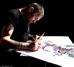 Canadian Colour (Neil. Moralee) Tags: neilmoralee man art artist artistic colour color black pen crayon ink tatoo work working painting drawing blackground street sunlight sun light arms male blackbackground