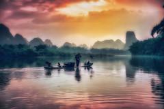 Guilin (Gio_guarda_le_stelle) Tags: guilin sunset river china cina travel viaggio paesaggio water fisherman 4 acqua fiume i bello atmsosphere
