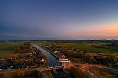 Afterglow of a sunset. (Alex-de-Haas) Tags: dji dutch europa europe fc6310 holland nederland nederlands netherlands noordholland p4p phantom phantom4 phantom4pro schoorldam schoorldammerbrug aerial aerialphotography beautiful beauty dusk landscape landschaft landschap lente mooi pracht quadcopter schemer schemering schoonheid spring sundown sunset zonsondergang warmenhuizen northholland