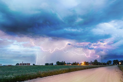 Electrifying Skies (Striking Photography by Bo Insogna) Tags: lightning bolts storms thunderstorms climatechange country skies sky clouds gas rural weather nature weldcounty dirtroads angryskies naturelandscapes coloradoweather rain fury jamesinsogna oil fracking electrifyingskies stacks composite canon 5div