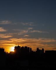 Winter sunset (andii1701) Tags: sunset melbourne winter sunray clouds sky blue orange skyline skyscrapers buildings city cbd richmond