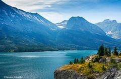 Dreams of Montana (Photosuze) Tags: glaciernationalpark landscape montana lake clouds sky trees water