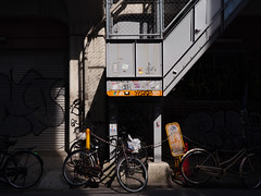 between the shadows (peaceblaster9) Tags: stairs wall bicycle bike street light shadow 自転車 光 影 壁 osaka 大阪