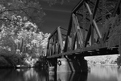 Railroad Bridge Over Erie Canal (Infrared) (dr_marvel) Tags: ir infrared rochester pittsford ny newyork bridge railroad canal eriecanal water waterway blackandwhite monochrome steel girders train trees