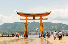 The Grand Torii Gate // In Explore (shiruichua) Tags: japan hiroshima miyajima island shrine torii gate otorri water low tide mountains orange blue canont5i 18135mm lens f3556 700d itsukushima