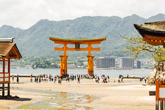 Torii Gate: Between Worlds (shiruichua) Tags: japan hiroshima miyajima shrine island itsukushima torii gate otorii water low tide mountains orange blue canont5i 18135mm lens f3556 700d