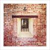 Barred (Daniela 59) Tags: window wall bricks brickwork brickwall wednesdaywalls squareformat building stellenbosch southafrica