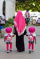 Watermelon Twins - Stonetown, Zanzibar (TravelsWithDan) Tags: family motheranddaughters identicaltwins preschoolgirls walking outdoors city urban people colors watermelonhats covered muslim stonetown zanzibar tanzania africa canong3x candid streetportrait khimir