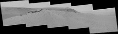 Rolling Terrain (encoded) (sjrankin) Tags: 3july2019 edited nasa mars msl curiosity galecrater dust panorama mountains sand sky haze rocks grayscale bayerencoded