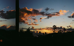 (isadora.jpg) Tags: 35mm film fujifilm fujicolor superia 400 pentax espio 105g point shoot sunset clouds gold pink glow split frame accident