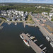 """Aerial photo shows a route section for the Finnish triathlon event """"Ironman 70.3"""" at the coast of the port district of Lahti, with yachts and motor boats"""
