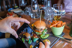 Food photography with the smartphone of a burger meal with sweet potato chips on a laid table in a Restaurant (verchmarco) Tags: im703finland finnland ironman sports lahti visitlahti travel finland people menschen food lebensmittel table tabelle noperson keineperson wine wein indoors drinnen woman frau adult erwachsene drink getränk restaurant grow wachsen party knife messer wood holz dinner abendessen child kind man mann chef führer beer bier kitchenware geschirr2019 2020 2021 2022 2023 2024 2025 2026 2027 2028 2029 2030 colours eos naturaleza dusk countryside fun path spain colour