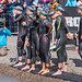 Professional female athletes with tracking footbands at the starting line of the Ironman competition, right before the first discipline swimming