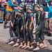 Concentrated professional athlete Laura Matthews with other pro athletes and women at the start of an Ironman 70.3, shortly before the swim discipline