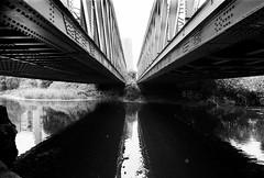 River Lea, London (a.pierre4840) Tags: olympus om3 zuiko 24mm f28 35mmfilm ilford ilfordhp5 hp5 hp5plus bw blackandwhite noiretblanc symmetry river bridge perspective reflections london england