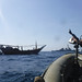 USS McFaul pulls alongside a Bahraini dhow during routine maritime security operations.