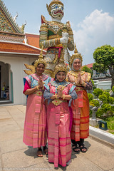 Visitors to Wat Arun in rented traditional Thai outfits (Alaskan Dude) Tags: travel thailand bangkok watpho watpo templeoftherecliningbuddha temples buddhisttemplecomplex art architecture cityscape