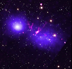 Cluster Merger: Galaxy Clusters Caught in a First Kiss (NASA's Marshall Space Flight Center) Tags: nasa nasasmarshallspaceflightcenter nasamarshall marshall msfc chandraxrayobservatory cxo solarsystembeyond astronomy astrophysics xray galaxy galaxycluster