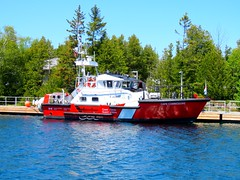 CCGS Cape Commodore (Zaklina & Zelimir) Tags: swim waves antenna crew captain flag nature motor savings safe leaf orange ball power canon bird fly save tobermory canada ontario huron lake national bruce park vacation green trees water ship boat red guard coast