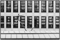 Tightrope Walker (Art de Lux) Tags: berlin germany deutschland federalforeignoffice auswärtigesamt tightropewalker seiltänzer rope seil facade fassade windows fenster roof dach sculpture skulptur trakwendisch art kunst architecture architektur lines linien geometry geometrie reflection spiegelung bw blackandwhite sw schwarzweis artdelux blackwhite