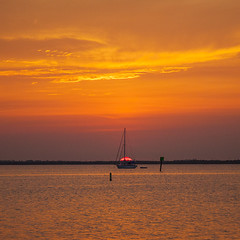 Sunrise (mimsjodi) Tags: sunrise sky clouds water indianriverlagoon titusvillefl boat sailboat