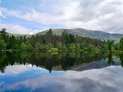 Glen Coe Lochan (lesleydugmore) Tags: lo han glencoelochan scotland highlands westhighland uk britain europe green trees water reflection mountain nationalnaturereserve outside outdoors rural countryside lake scenic picturesque tranqiil mirrorreflection sky cloud white blue colour hue