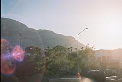 D067677-R1-18-19A (IrvLephunk) Tags: sun sunset nature city plants discoball disco scattered sky orange car mountain mountains huasteca monterrey nuevoleon antena nofilter noprocess raw 35mm film filmphotography bluesky silouhette