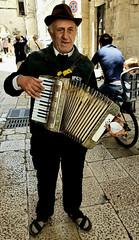 The streets of Bari (Leaning Ladder) Tags: bari italy italia puglia apulia accordion faces street leaning ladder leaningladder