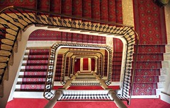 Stairway to the underworld (PeterThoeny) Tags: grandhotelmajestic verbania italy hotel house architecture lagomaggiore indoor stairway gold red symmetry onepointsymmetry sony a6000 selp1650 1xp raw photomatix hdr qualityhdr qualityhdrphotography fav200