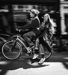 Drag Race (The Rolling Spoke) Tags: smoke drag double ride passenger street streetphotography bnw blackandwhite cycle girl bike bicycle bici bicicletta bisiklet fiets velo amsterdam