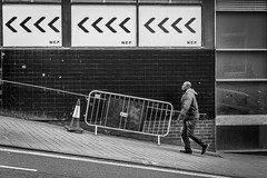 The Only Way Is Up (Leanne Boulton) Tags: urban street candid streetphotography candidstreetphotography streetlife urbanlandscape man male walking uphill face expression atmosphere mood arrows composition framing juxtaposition steep gradient slope climb lines geometry tone texture detail depth naturallight outdoor light shade city scene human life living humanity society culture lifestyle people canon canon5dmkiii 70mm ef2470mmf28liiusm black white blackwhite bw mono blackandwhite monochrome glasgow scotland uk