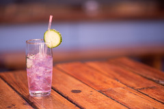 Drink with straw on table in restaurant (Rushay) Tags: glass drink table gin alcohol straw purple grahamstown southafrica
