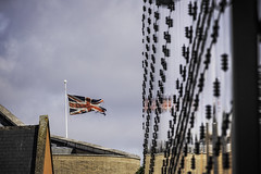 I've seen battle flags in better condition (tootdood) Tags: canon6dmkii manchester blue sky white clouds cheethamsschoolofmusic ive seen better battle flag unionflag unionjack reflection