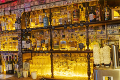 Behind the bar (Tambako the Jaguar) Tags: pub bar bottles glasses drinks yellow light lit behind pretty colorful waterford ireland nikon d5 notes money alcohol nightlife whisky gin beverage restaurant