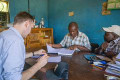 Klaus going over outturn numbers, quality scores and prices with Josphat and Charles at Kieni (Coffee Collective) Tags: coffee kenya directtrade nyeri kieni mugaga karatina coffeecollective