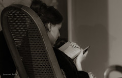 Nothing better than a good book (Petoskey Drones) Tags: woman book chair bw sepia
