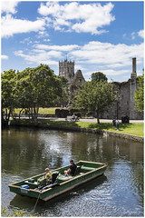 A Day at the Office (clive_metcalfe) Tags: christchurch riveravon river dorset uk fishermen bell tower priory swann sygnet people water constableshouse norman house trees sky blue clouds dogs seat bench path chimimney ruins building clock punt