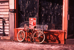 Morning in Chinatown (ocarmona) Tags: bicycles bicycle red velvia velvia50 32 32asa toronto chinatown pentax me super 35mm slide e6 film filmphotography 50mm