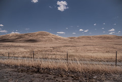 517 - No Country For Old Men (kosmekosme) Tags: nocountryforoldmen ornot nature barbedwire barbed wire dry country outside deserted hill hills countryside america usa unitedstatesofamerica cloud clouds cloudy sky hot warm desert ontheroad travel travelling d80