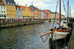 Nyhavn - Copenhagen (Agha Asif Ali) Tags: nyhavn europe denmark copenhagen holiday fun photographyforrecreation photographyforfun photographer picture travelphotography photo travel water canal 17th century boats colors colorful old buildings windows wood men people blue sky clouds mast poles trip pleasure frie ds friends aghaasifali canon mirrorless m3