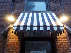 UPT-7035358 (Tombstone738) Tags: chicago uptown street awning lights night